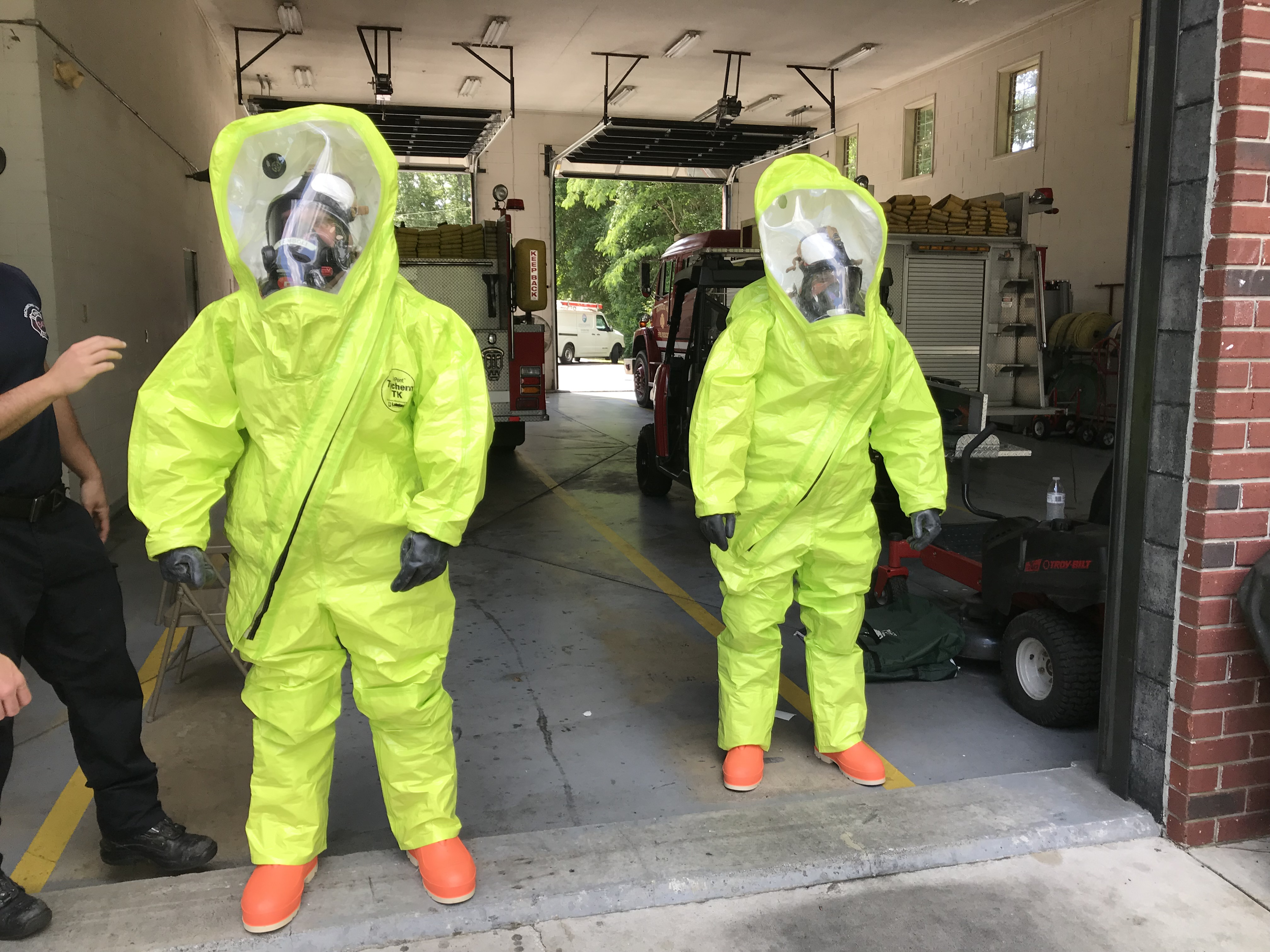 Two firefighters in hazmat suits